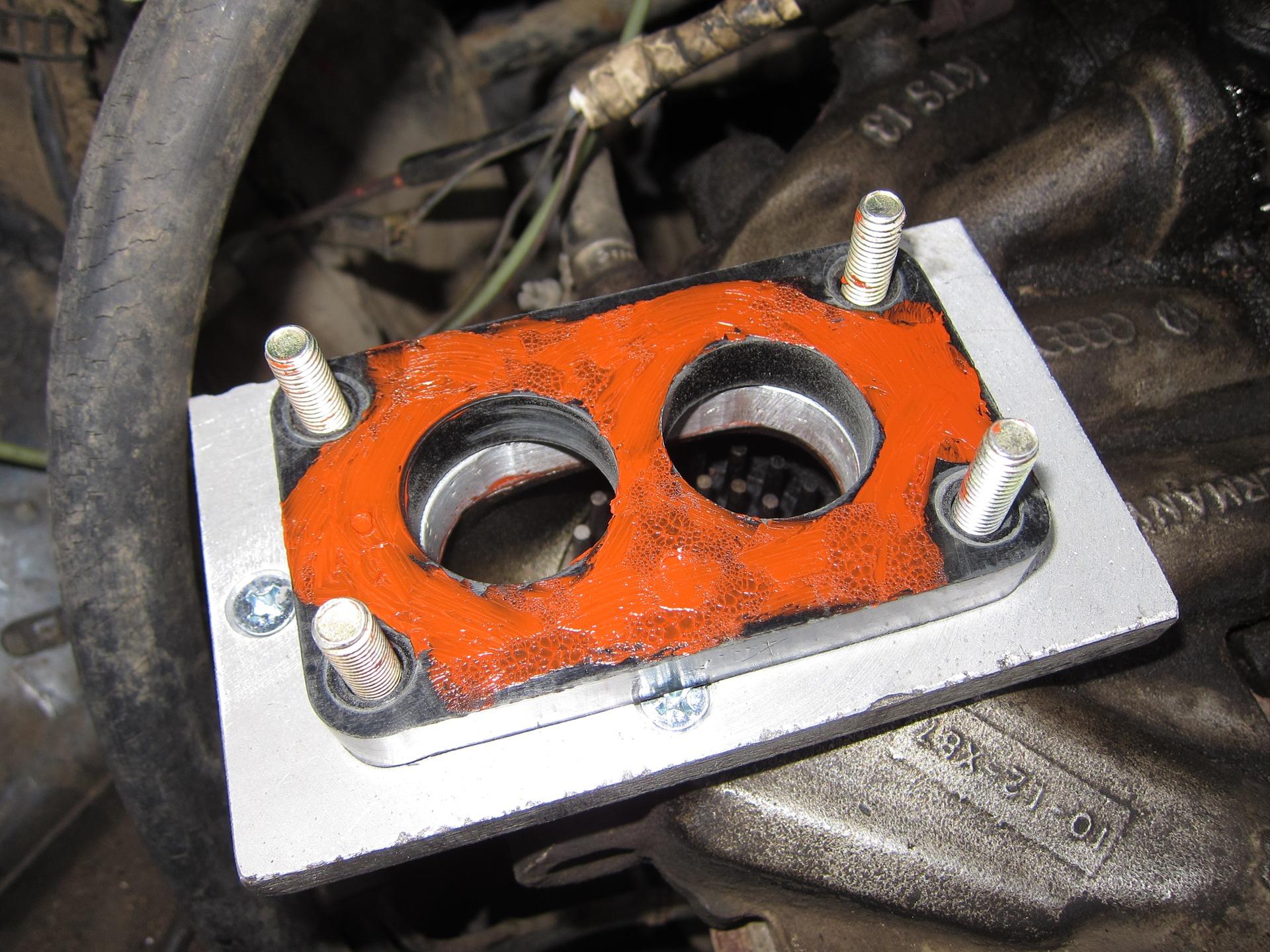 Несколько плюсов установки проставки на бензиновый двигатель